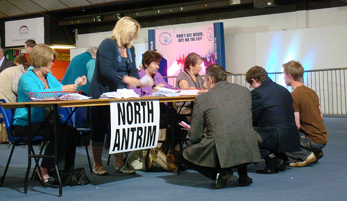 Ian Paisley Junior and others hunkered down on the ground tallying votes being validated face down at the 2009 European Election