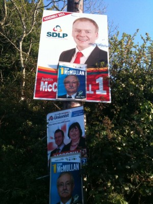 Sinn Fein posters mounted on top of other party posters in East Antrim