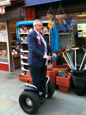 PUP's Brian Ervine on a Segway on an East Belfast pavement