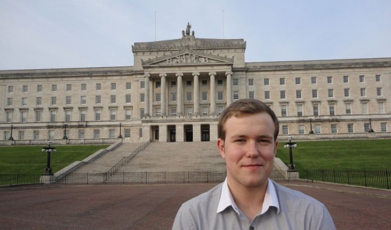 Stephen Stewart, 18 year old East Belfast independent standing in front of Parliament Buildings