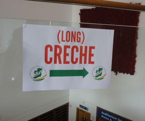Sign saying (Long) Creche at Sinn Féin ard fheis in Belfast