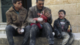 A man holds a baby saved from under rubble, who survived what activists say was an airstrike by forces loyal to Syrian President © Reuters/Hosam Katan