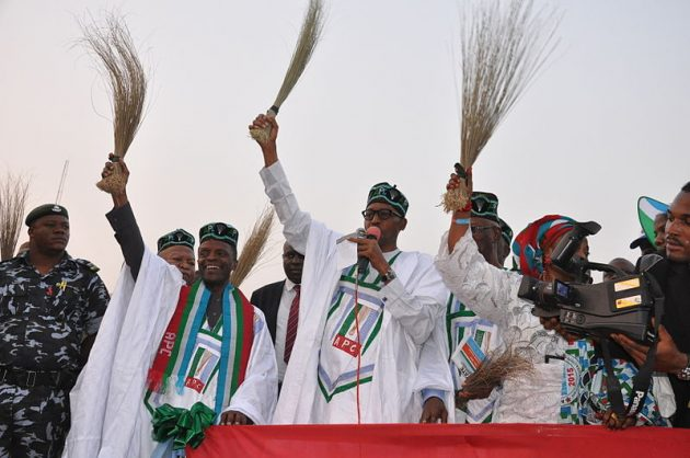 "General Buhari holding a broom ""to sweep Nigerian politics clean""£ at a campign rally. Photo: Heinrich Böll Foundation."