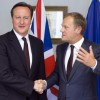 British Prime Minister David Cameron, left, shakes hands with European Council President Donald Tusk during a meeting on the sidelines of an EU summit in Brussels, on Thursday, June 25, 2015. (Julien Warnand/Pool Photo via AP)