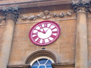 "The clock on the Bristol Exchange giving priority to local time, but also indicating ""railway time"", 10 minutes ahead."