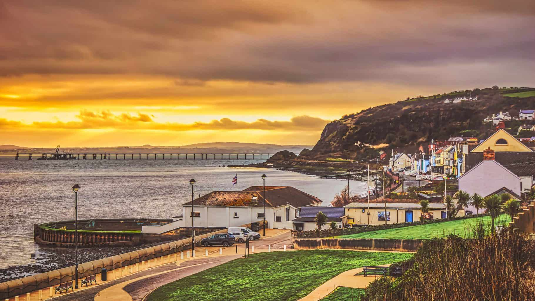 A low-hanging sun combined with an incoming winter storm created this beautiful sunset over Whitehead on the coast of Belfast Lough. The coast of County Down, on the far side of the lough, can be seen on the horizon (Jan., 2020).