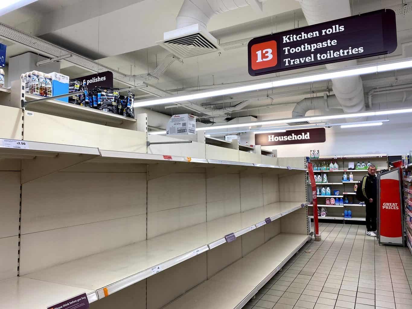 Shelves emptied of toilet paper, due to panic buying